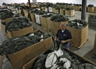 Bret Clippinger, Sales/Operations Manager at the Government Liquidation on November 6, 2014. with 4 1/2 truck loads of parachutes. (Columbus Dispatch photo by Tom Dodge)